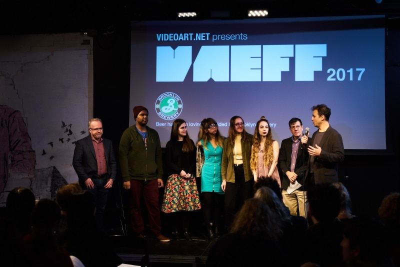 The team with moderator Mark Alpert and festival director Dan Fine on Saturday night.