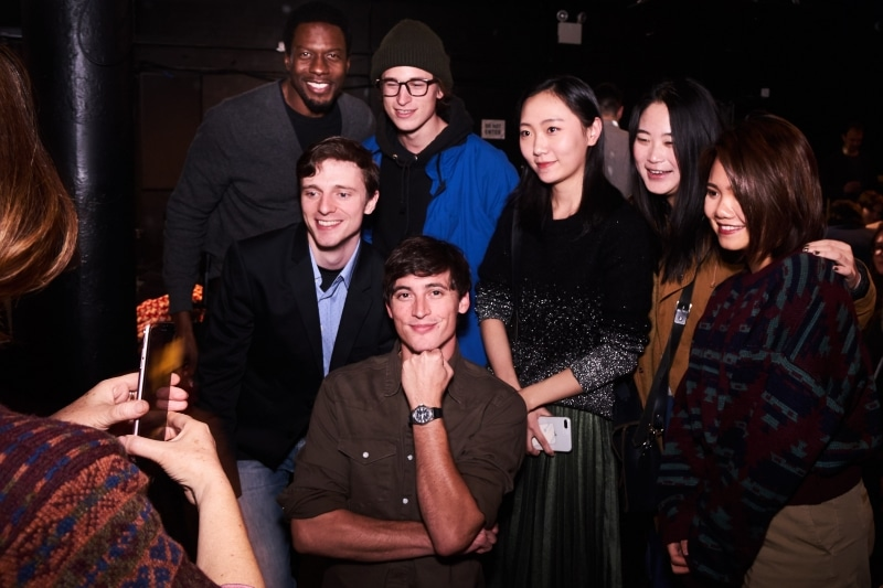 "The cast of ""The Performance"" pose with director Miao Hao."